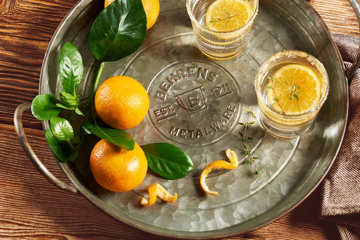 Vintage galvanized steel serving tray with lemon on a wood block counter top