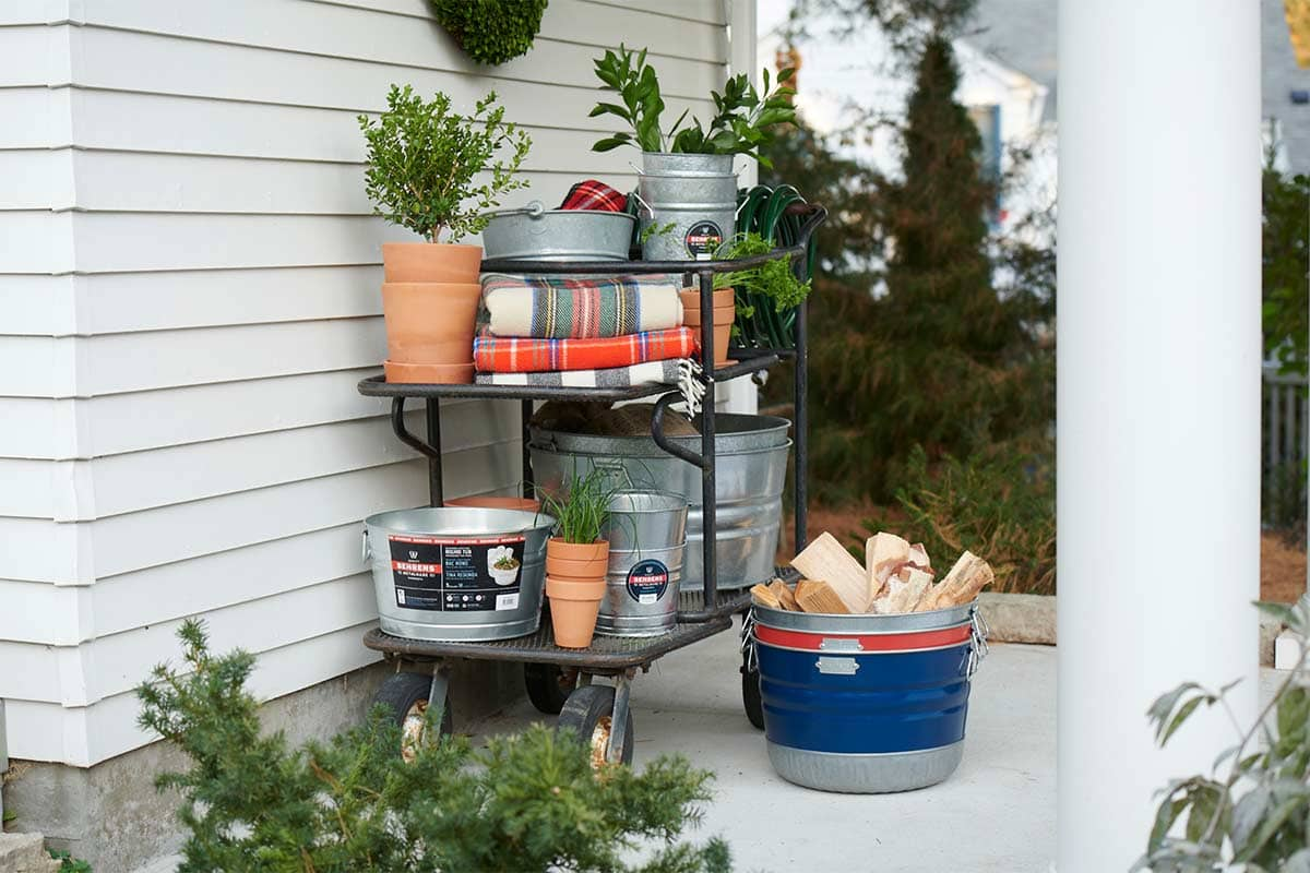 On a patio with gardening equipment featuring galvanized steel tubs.